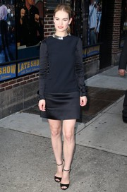Lily James went modern and minimalist in a Mugler LBD with a metallic collar and an open back during her visit to 'Letterman.'