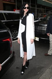 Krysten Ritter headed to 'The Today Show' wearing a white Genny duster coat with lace-accented sleeves.