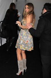 Carmen mixed sweet and sexy in a floral sundress and scrunched gray suede boots.