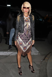 Keri donned a cropped leather jacket with fringe adorned shoulders for Fashion Week.