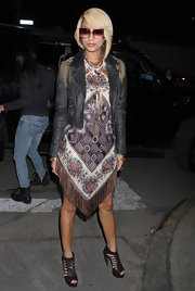 Keri donned a geometric and abstract print dress with a fringed hem under a tough-chic leather jacket to Fashion Week.
