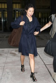 Sandra Oh styled her look with chic black gladiator heels.