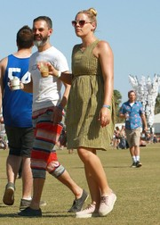 Busy Philipps opted for a pair of white canvas sneakers to team with her dress.