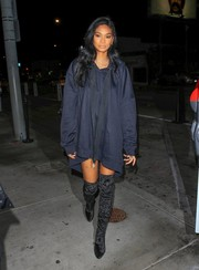Chanel Iman hid her slim figure under a baggy navy hoodie for a night out in LA.