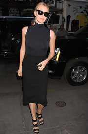 Charlize Theron appeared on the 'Today' show wearing a strappy pair of gray and black sandals.