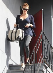 Charlize Theron carried a cream tote trimmed in black leather.