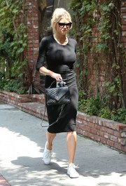 Charlotte McKinney showed off her curves in a body-con black sweater dress while shopping in Beverly Hills.