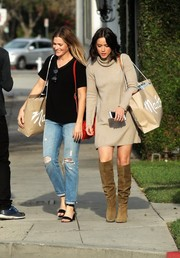 Chloe Bennet nailed fall chic with this beige turtleneck sweater dress while shopping in Beverly Hills.