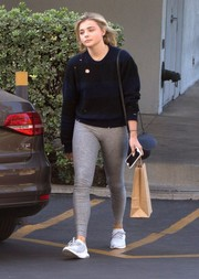 Chloe Grace Moretz kept the comfy vibe going with a pair of gray leggings by Outdoor Voices.