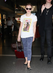Chloe Moretz looked casual walking through LAX wearing a pair of mid-rise capri baroque print jeans in plum.