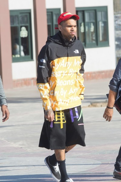'By Any Means'.  Chris Brown stayed warm in a waterproof jacket by The North Face.