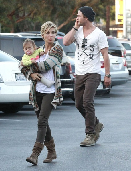 Chris Hemsworth chose a graphic V-neck tee for his casual look while out getting groceries with his wife and daughter.