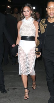 Chrissy Teigen made eyes pop with this sheer white Zeynep Arçay dress while out in New York City.