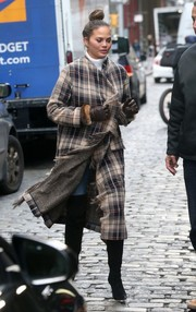 Chrissy Teigen got all bundled up in a fringed plaid coat by Chloe for a cold day out in New York City.