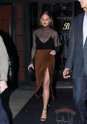 Chrissy Teigen amped up the sexiness with a high-slit suede pencil skirt by Sally LaPointe.