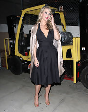 We loved the classic retro feel of Christie Brinkley's black tie-waist dress.