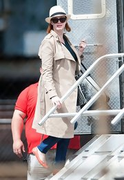 Christina Hendricks chose a classic trench for her on-set look for 'How To Catch A Monster.'