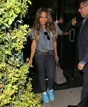 Christina Milian wore a gray leather Hermes Birkin with her blue outfit.