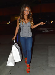 Christina Milian's suede orange platforms were a powerful pop of color in contrast to the rest of her low-key look.