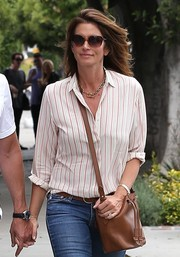 Cindy Crawford did some retail therapy in Beverly Hills carrying a classic brown bucket bag.
