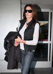 Cindy Crawford kept her travel style sporty in a black down vest and killer shades.