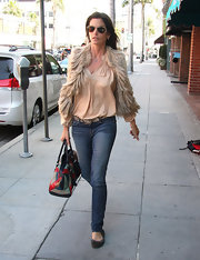 Cindy Crawford hit the streets in a pair of skinny jeans and flat, for an effortlessly stylish look.