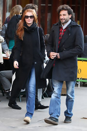 Cintia Dicker was seen out in NYC wearing a black trenchcoat and a pair of washed out jeans.
