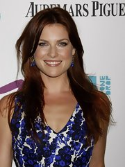 Ali Larter paired her blue print dress, with newly dyed red hair.
