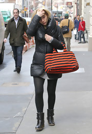 Claire Danes bundled up in a puffy coat and black flat boots complete with buckled detailing.