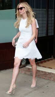 Jennifer Lawrence completed her summery ensemble with nude ankle-strap sandals.