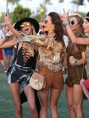 Alessandra Ambrosio accessorized with a two-tone Chloe Drew bag during Coachella.