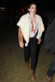 Emma Watson bundled up in this shearing leather jacket at night for Coachella.