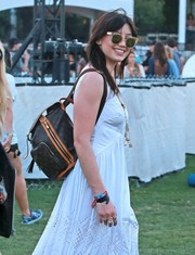 Daisy Lowe completed her accessories with cute cateye sunnies.