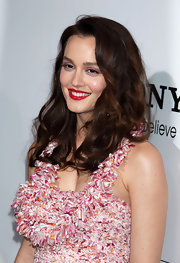 Leighton added some glam to her juicy red lips with voluminous curls.