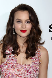 Leighton Meester vamped up her floral look with a swipe of juicy red lipstick. Long brunette curls and a natural face completed her look.