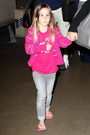 A fushia pink cardigan kept Coco Arquette stylishly snug as she arrived for a flight at LAX.