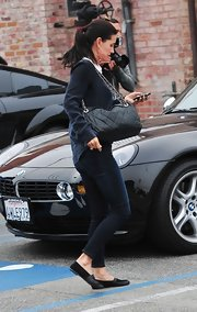 Courteney Cox Arquette went shopping in black leather loafers.