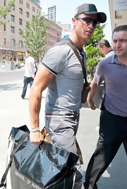 Cristiano Ronaldo shielded from the sun in NYC in a black hat.