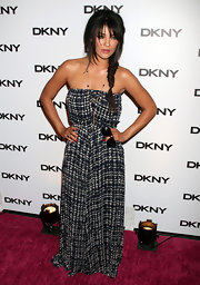 Jessica Szohr put a twist in her dark style with a plaid strapless maxi dress at the DKNY Sunglass Soiree. The actress went for a hippie aesthetic with long pendant necklaces and a fishtail braid. Jessica appropriately carried a pair of shades for the occasion.
