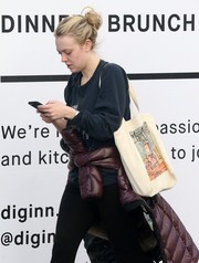 Dakota Fanning carried an adorable 'Charlotte's Web' bag while out and about in New York City.