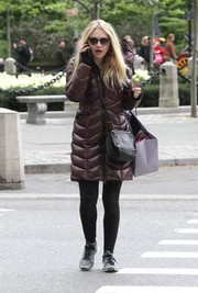 Dakota Fanning looked toasty in her puffer coat while shopping in Manhattan.