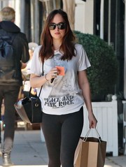 Dakota Johnson finished off her look with a pair of wayfarer sunglasses.