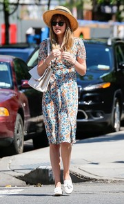 Dakota Johnson stepped out in New York City looking girly in a colorful print dress.