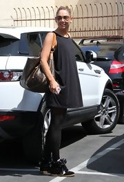 An oversized tank topped off Kym Johnson's workout ensemble.