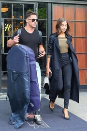 Olivia Culpo was spotted outside her New York City hotel looking stylish in a black trenchcoat by Victoria Beckham.