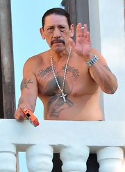 Danny Trejo has a bird tattooed on his right bicep.