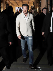David Beckham prevented his cream cardigan from looking too preppy with a pair of ripped jeans.