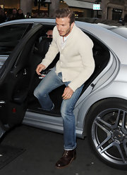 David Beckham was cool and casual in light jeans and brown lace-up kicks.