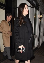 Liv Tyler accessorized with a stylish black hand-strap clutch while attending David Beckham's fashion brand launch party.