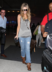 Delta Goodrem was dressed down in a gray knit tank top and ripped jeans as she arrived on a flight at LAX.